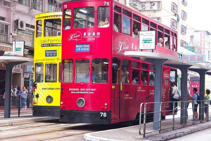 """Affectionately called """"ding ding"""" trams, take a seat on the upper deck for a sightseeing tour of areas like Happy Valley, Wan Chai and Causeway Bay."""
