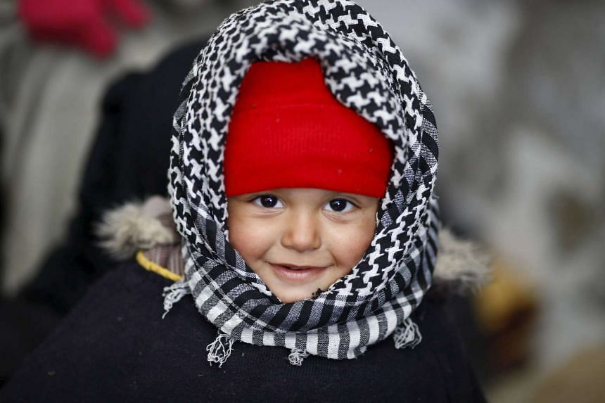 A displaced Syrian boy is pictured near Syria's border with Turkey on Feb 6, 2016.