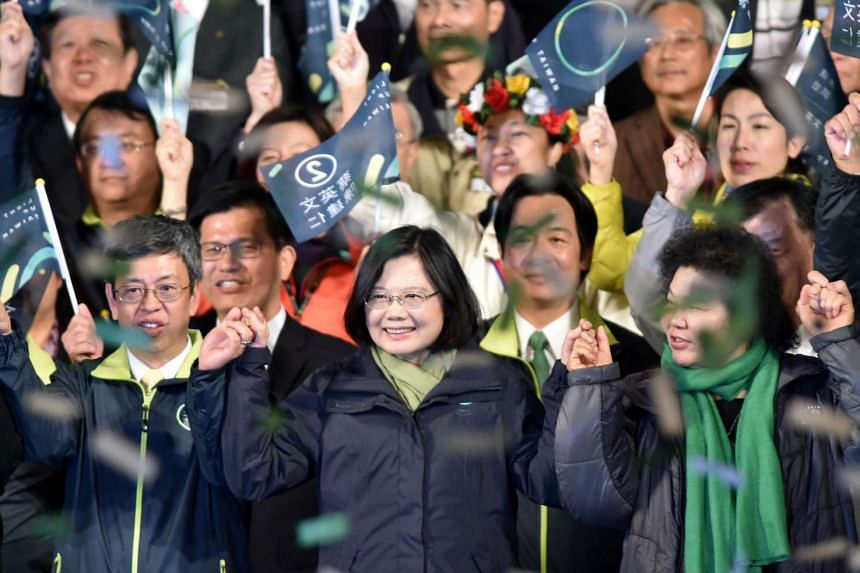 Taiwan's President-elect Tsai Ing-wen (centre) thanks supporters after winning the elections in Taipei on Jan 15, 2016.