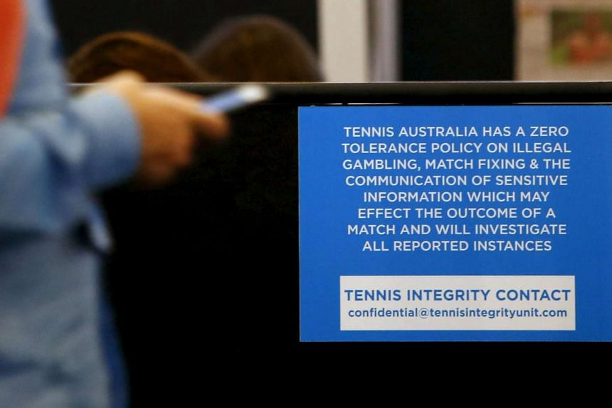 A sign displaying the contact details of the Tennis Integrity Unit at the Australian Open in Melbourne on Jan 21.