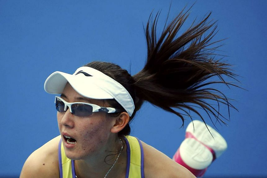 Zheng (above, in a file photo) won 7-6 (7/1), 6-1 to march into the final eight in Doha.