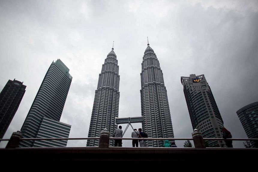 The Petronas Towers at the central business district in Kuala Lumpur, Malaysia.