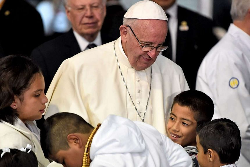 Pope Francis is welcomed by children during his visit to the Federico Gómez Children's Hospital in Mexico City on Feb 14, 2016.