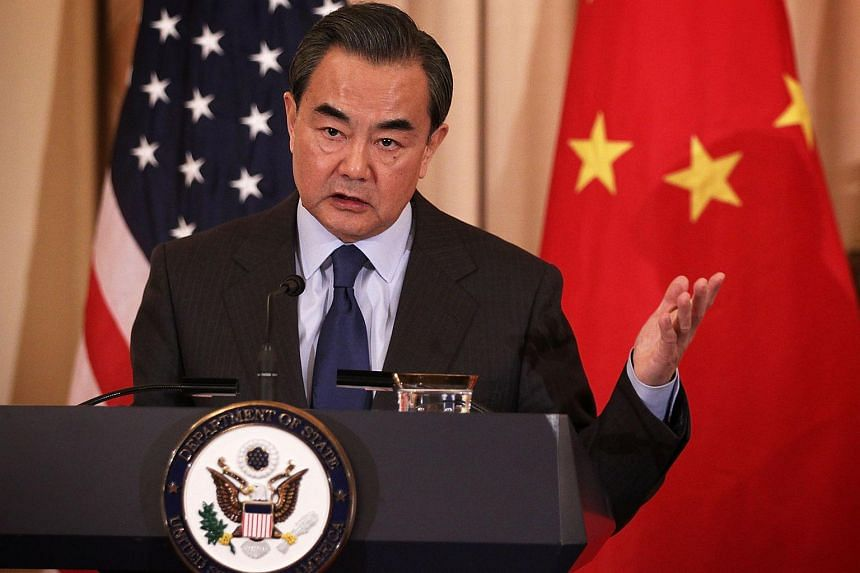 Chinese Foreign Minister Wang Yi participates in a joined news conference with US Secretary of State John Kerry at the State Department on Feb 23, 2016.