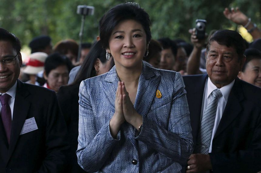 Ousted former Thai Prime Minister Yingluck Shinawatra gestures as she arrives at the Supreme Court in Bangkok on Feb 26, 2016.