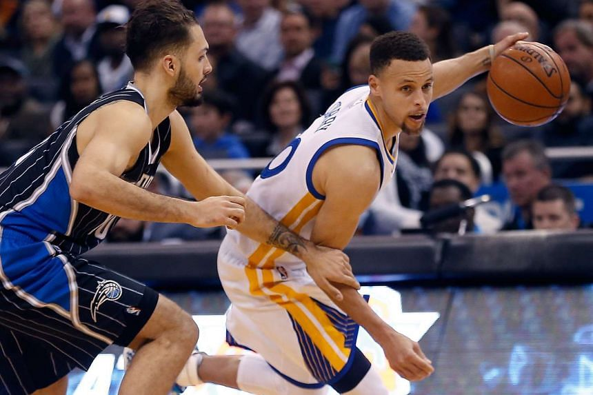 Golden State Warriors guard Stephen Curry (right) drives past Orlando Magic's Evan Fournier en route to a 51-point outing.
