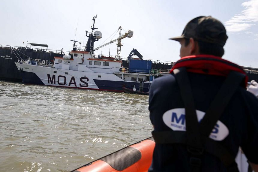A Migrant Offshore Aid Station (MOAS) crew drives a boat to return to the MOAS ship, MV Phoenix, at the Chao Phraya river in Thailand.