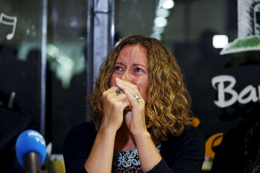 Tracy Bantleman, the wife of Canadian teacher Neil Bantleman, reacts during a news conference in Jakarta.