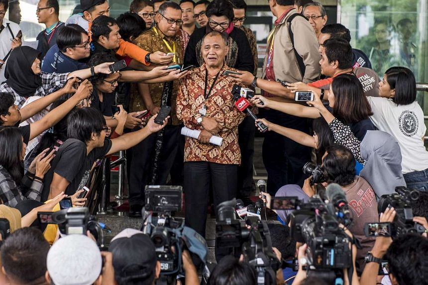 The chairman of Indonesia's Corruption Eradication Commission (KPK) Agus Rahardjo speaks with the media outside the KPK building in Jakarta.