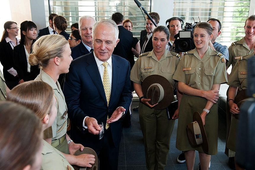 Mr Turnbull speaking to army cadets at the Australian Defence Force Academy in Canberra yesterday after the launch of the White Paper setting out greater spending on defence. He said Australia needed its military to be ready to protect its interests