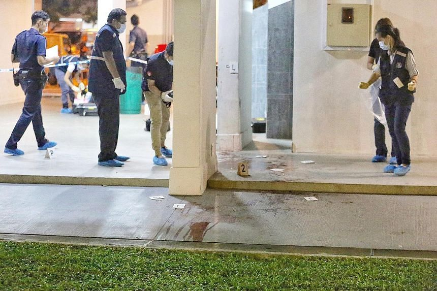 Bloodstains were visible 100m from the coffee shop. Mr Ang, found with neck injuries, was taken to Tan Tock Seng Hospital, where he died.