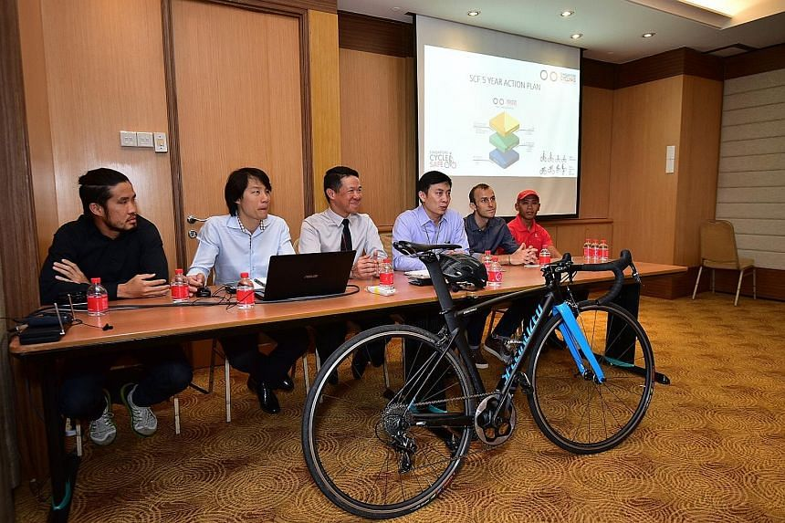 (From left) Adrian Ng, head coach; Samuel Yang, sport & technical manager; Hing Siong Chen, honorary secretary; Jeffrey Goh, president; Bastian Dohling, vice-president (road); and Muhammad Hairul Nazwa, vice-president (BMX). The SCF introduced a new