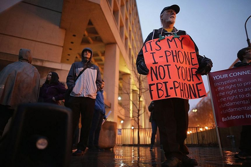 Protesters outside the FBI headquarters in Washington DC on Tuesday. Apple says it is only protecting the privacy of its customers.