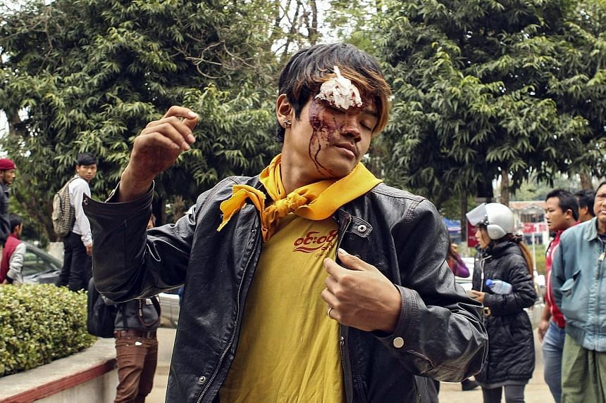 An injured member of a community-based anti-narcotics campaign group arriving at a hospital in Myit Kyi Na, in Myanmar's northern Kachin state, yesterday. The group claims that it was attacked by armed poppy farmers while trying to destroy opium fiel