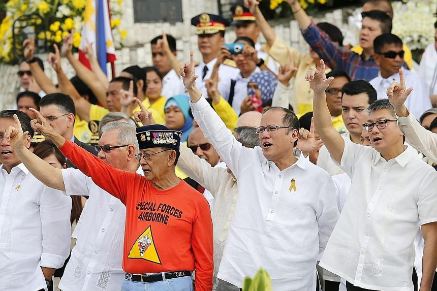 Philippine President Benigno Aquino (second from right) and former president Fidel Ramos (second from left) led the celebration at the People Power monument in Quezon city yesterday to mark the 30th anniversary of the fall of dictator Ferdinand Marco