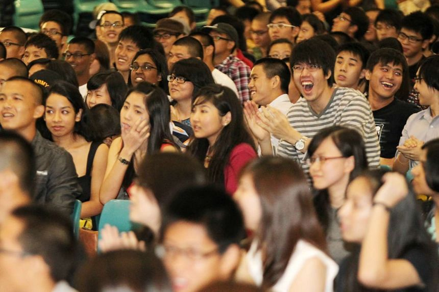 Anglo-Chinese Junior College students cheering during the release of the school GCE A-levels results on March 2, 2012.