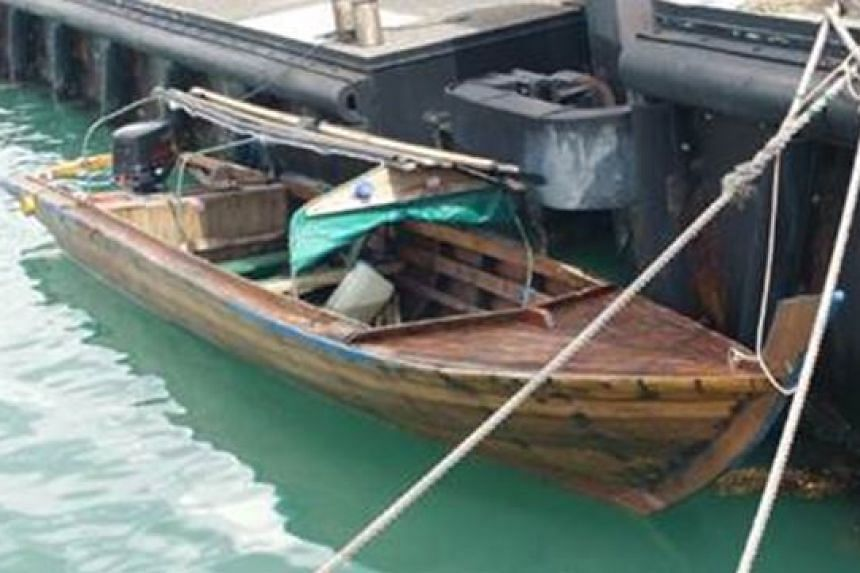 Police Coast Guard officers spotted a suspicious wooden craft in Singapore waters on Feb 26, 2016.