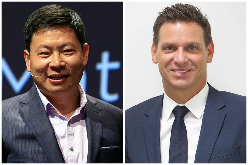 Richard Yu (left), CEO of Huawei, and Oliver Kaltner, CEO of Leica.
