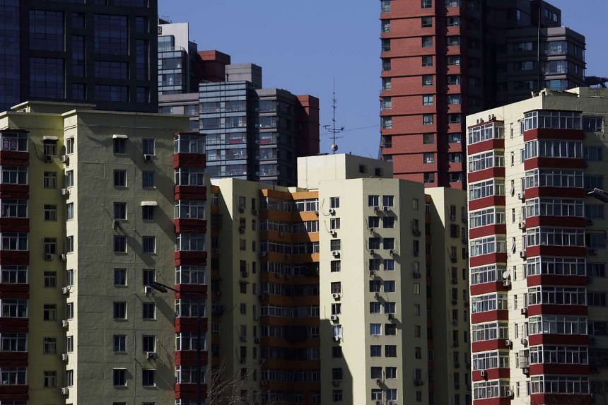 Commercial and residential buildings stand in Beijing, China.