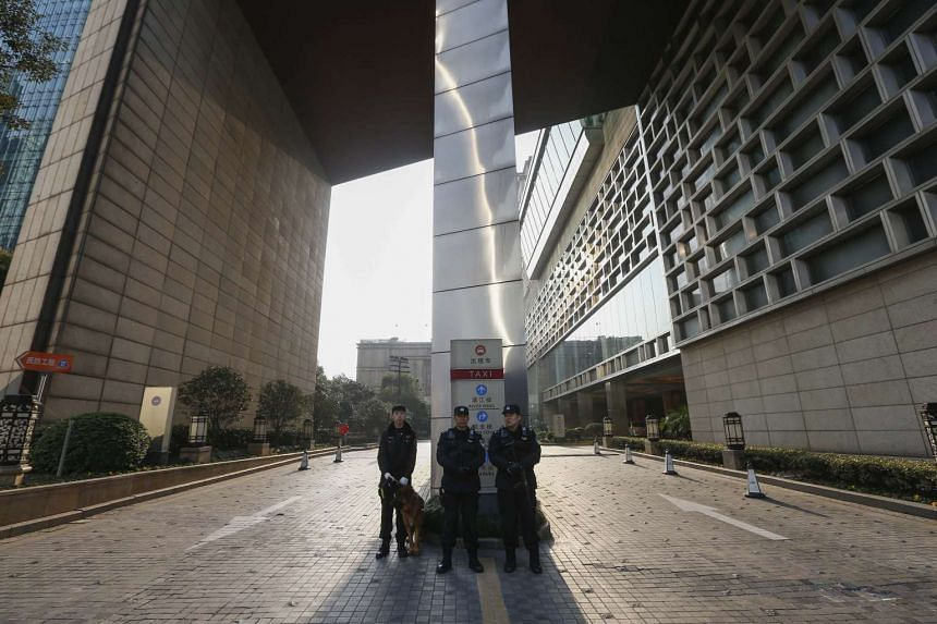 Chinese police keep watch outside, a day before the start of the G20 Finance Ministers and Central Bank Governors Meeting in Shanghai, on Feb 25, 2016.