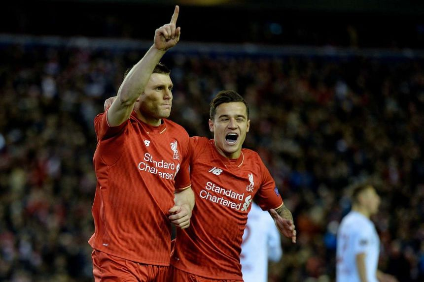 Liverpool's James Milner (left) celebrates scoring the 1-0 goal with team mate Philippe Coutinho.