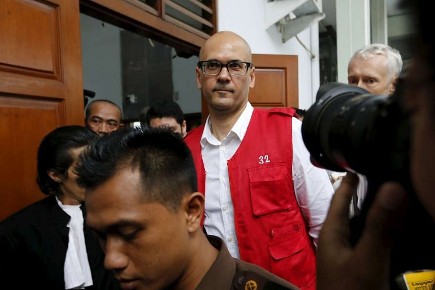 Canadian Neil Bantleman (centre) walks during a break in his trial at South Jakarta's Court, Indonesia, on April 2, 2015.