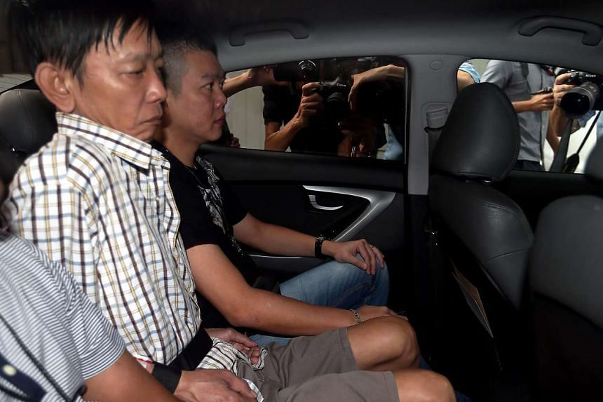 Khor Tzoong Meng (second from left) allegedly caused the death of Mr Ang Kim Keat, 38, at the void deck of Block 23, Hougang Avenue 3.