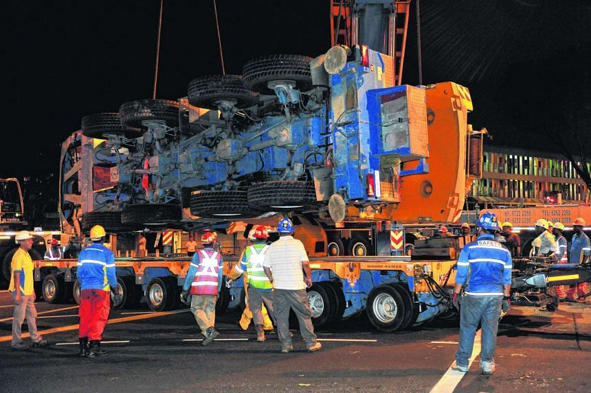 The mobile crane being loaded onto the trailer at 2.36am.
