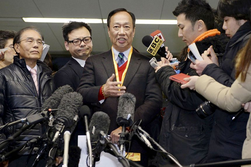 Mr Terry Gou (centre), founder and chairman of Taiwan's Foxconn Technology, at a press conference earlier this month after meeting Sharp executives in Osaka regarding a takeover of the Japanese electronics company.