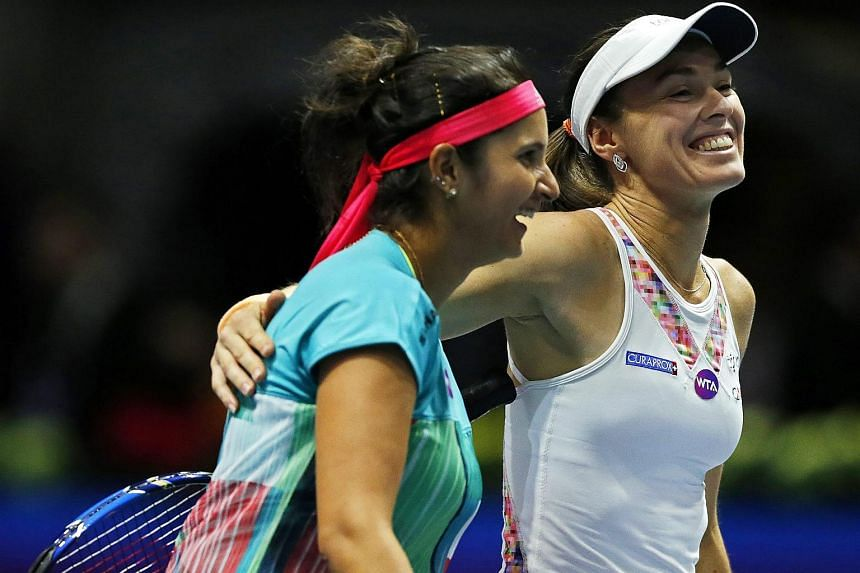 Martina Hingis (right) and Sania Mirza (left) celebrating after defeating Vera Dushevina and Barbora Krejckova in their doubles final of the St. P etersburg Ladies Trophy 2016 tennis tournament on Feb 14, 2016.