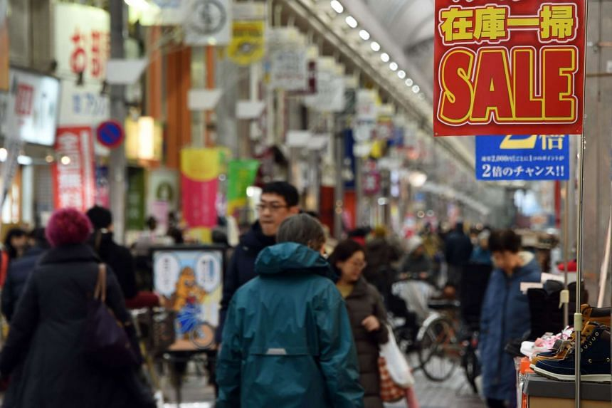People at a shopping arcade in Tokyo on Jan 29.