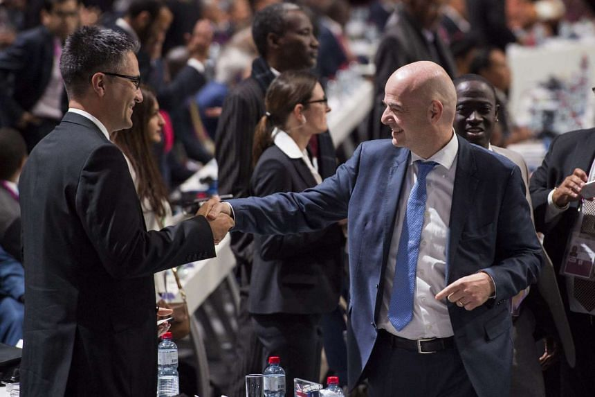 Swiss Gianni Infantino (right), candidate for Fifa President, seen after the first vote for the election for a new president, at the Extraordinary FIFA Congress 2016 held at the Hallenstadion in Zurich, Switzerland, on Feb 26, 2016.