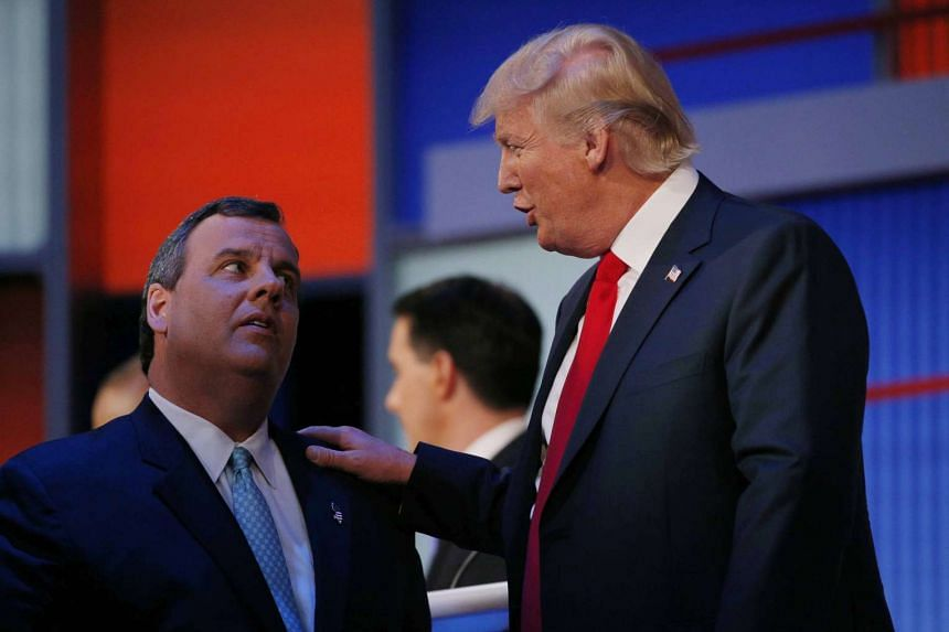 New Jersey Governor Chris Christie (left) talks to businessman Donald Trump in the midst of the first official Republican presidential candidates debate of the 2016 US presidential campaign in Cleveland, Ohio on Aug 6, 2015.