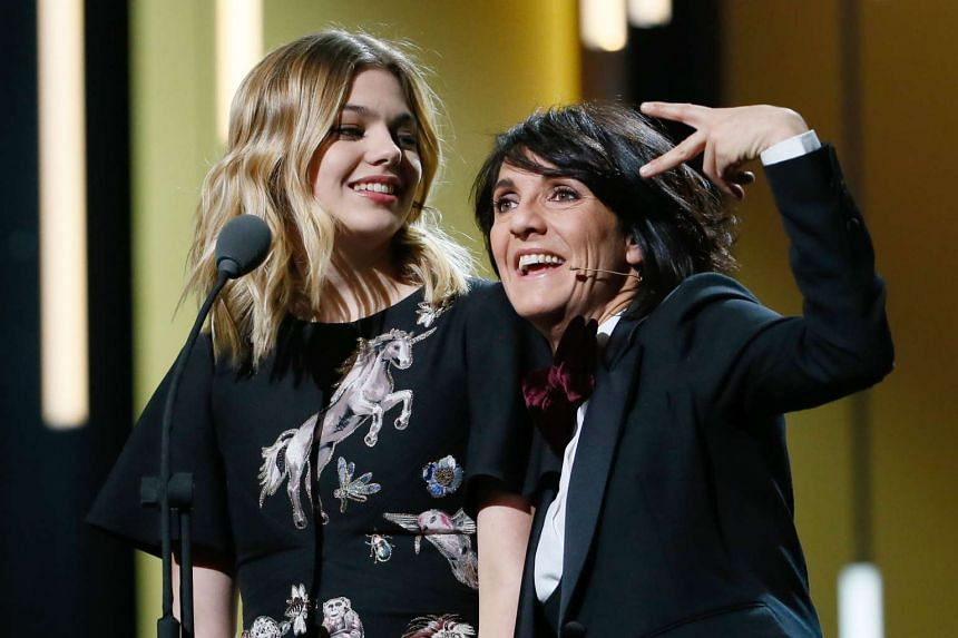 French singer and actress Louane Emera (left) and French actress and Master of Ceremony Florence Foresti at the 41st edition of the Cesar Ceremony at the Theatre du Chatelet in Paris on Feb 26, 2016.