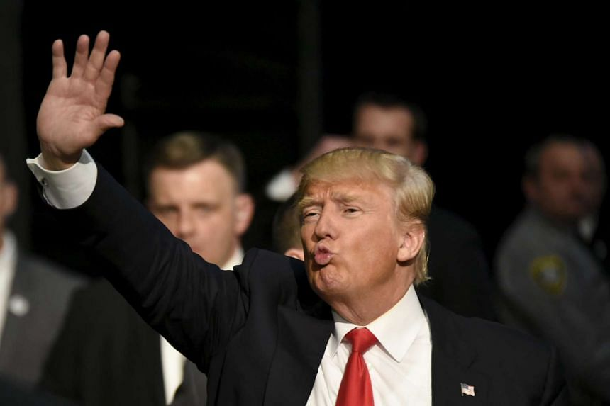 Republican presidential candidate Donald Trump greets supporters after a campaign rally in Oklahoma City on Feb 26, 2016.