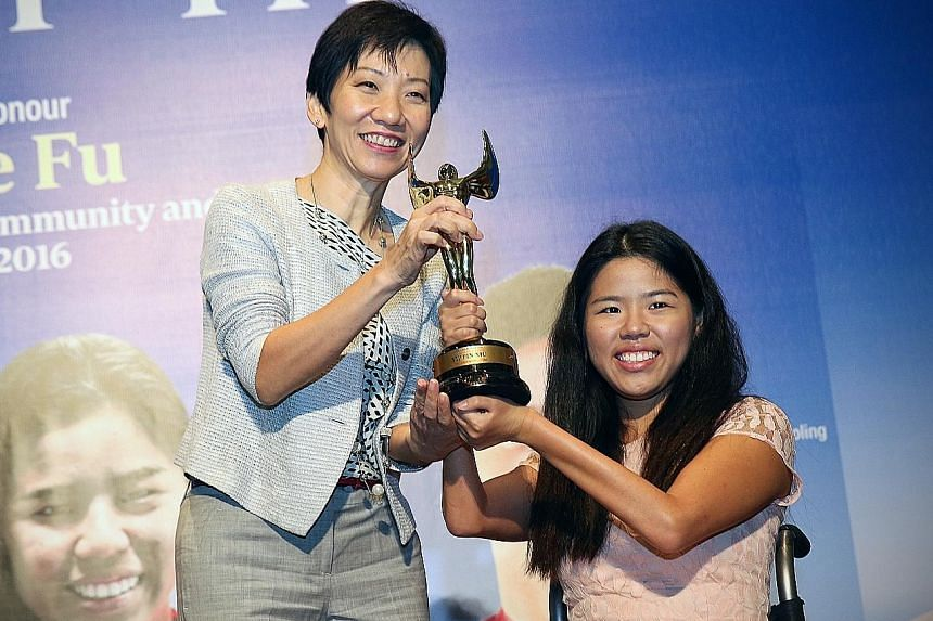 Para-swimmer Yip Pin Xiu, 24, receiving her Straits Times Athlete of the Year award from Minister for Culture, Community and Youth Grace Fu yesterday. The world record-breaker and Asean Para Games champion edged out Shayna Ng (bowling), Shanti Pereir