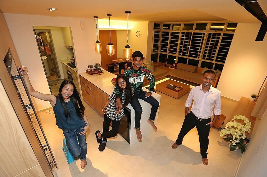 Civil servant Andrew Joachim with his wife Rozita Zin, daughter Nur Iman and son Mikail. The master bedroom (above) has a platform with concealed storage; and the entry way (left) to the living room.