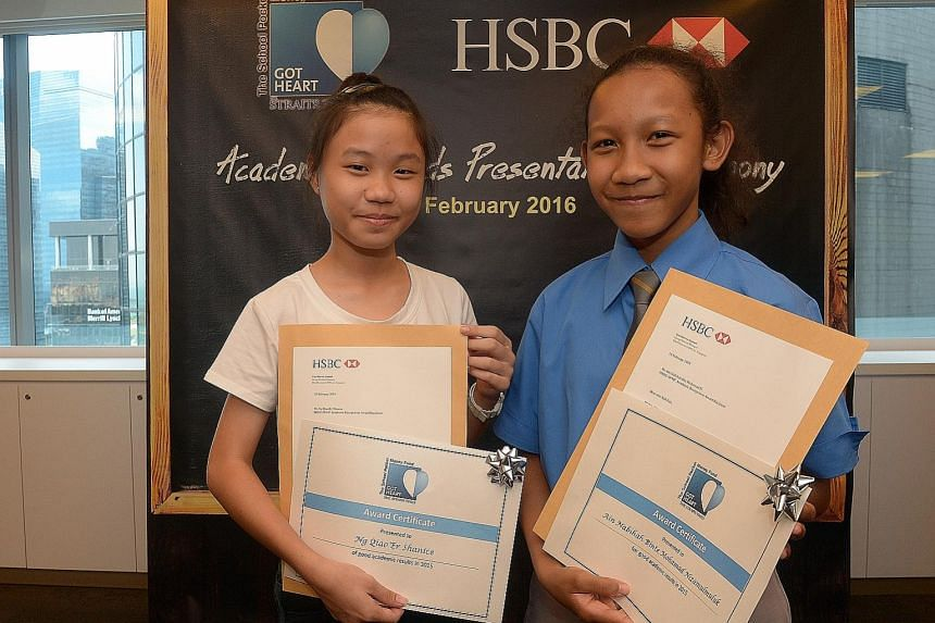 Shanice Ng (far left) and Ain Nabihah, both 13, were among 10 beneficiaries of The Straits Times School Pocket Money Fund who were rewarded for their high PSLE scores with a cash prize from HSBC.