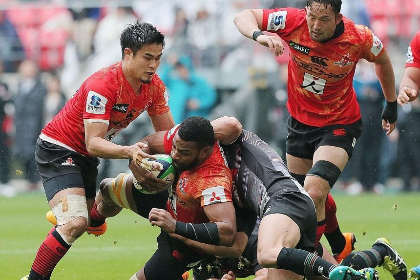 The Sunwolves' Andrew Durutalo (centre) being tackled during a charity rugby match in Japan this month. The team make their Super Rugby debut today against the Lions of South Africa, and face a flight schedule encompassing more than 80,000km this sea