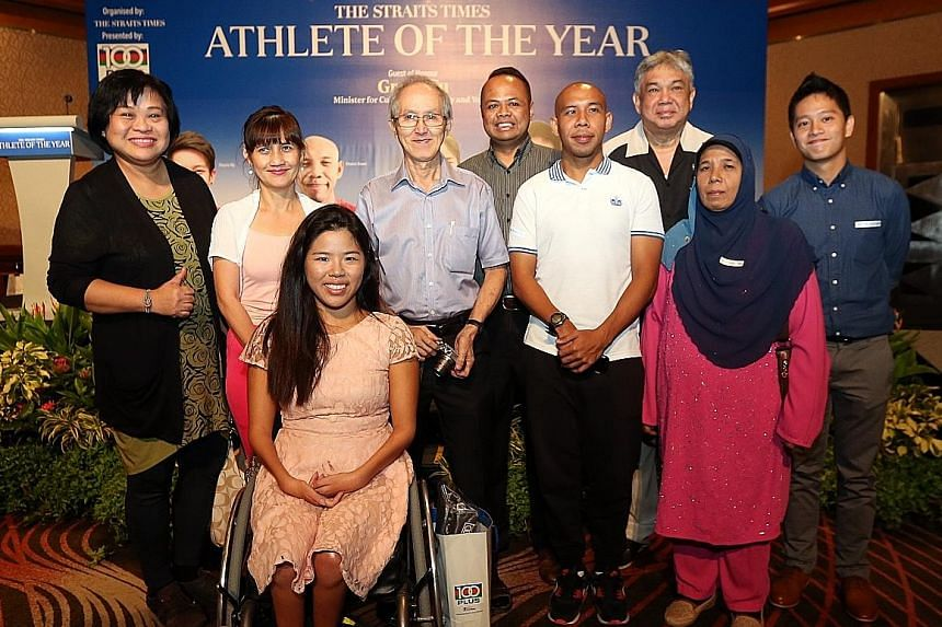Yip and fellow nominee Khairul Anwar (third from right) with some of the 20 ST readers invited to the event. The ST Athlete of the Year accolade was launched in 2008 and is backed by F&N's 100Plus.