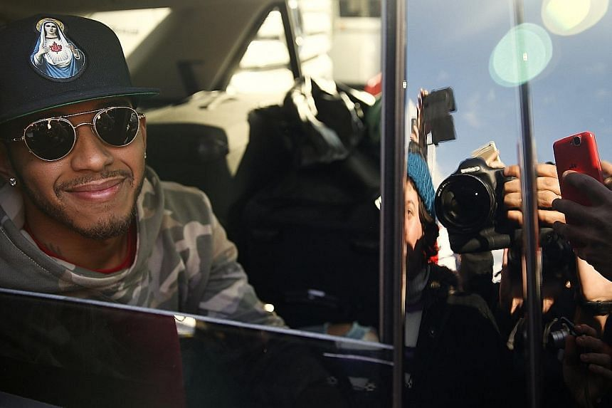 Lewis Hamilton posing for photos as he leaves Spain's Circuit de Catalunya yesterday. The triple F1 world champion completed 342 laps totalling 1,592km for the first pre-season test.