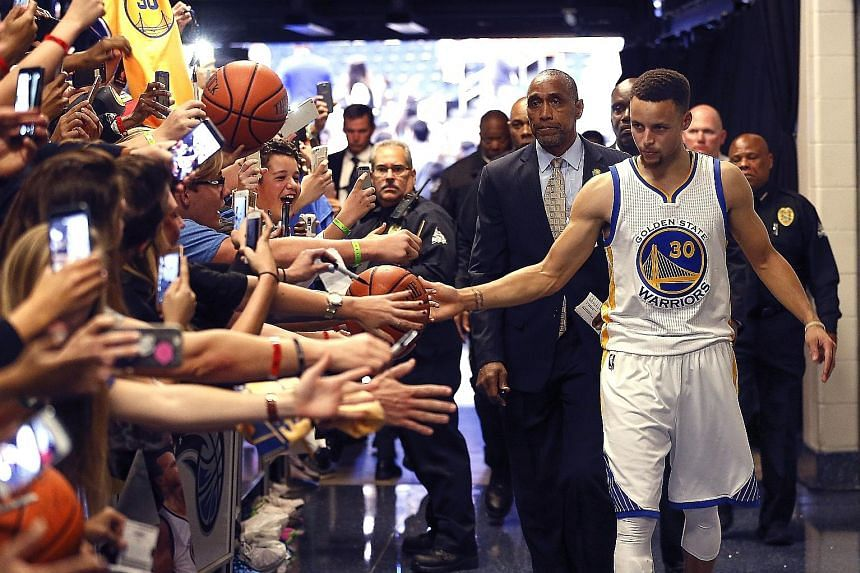 Warriors guard Stephen Curry thanking fans in the tunnel after Golden State's 130-114 victory over Orlando at Amway Centre. They need 21 wins from their final 25 games to beat the regular-season record of 72 wins set by the Chicago Bulls in 1996-97.