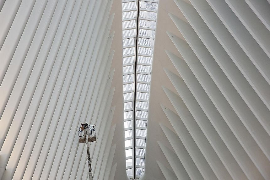 Designed by Santiago Calatrava (above), the Oculus (left) is a bird-like, dazzling white structure with a voluminous interior (below).