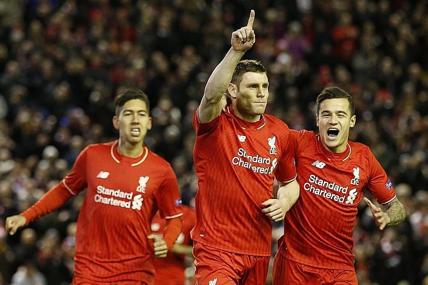 James Milner (centre) celebrating with Roberto Firmino (left) and Philippe Coutinho after netting his spot-kick against Augsburg. The only goal over two legs took the Reds into the Europa League last 16, where they were drawn against long-time rivals