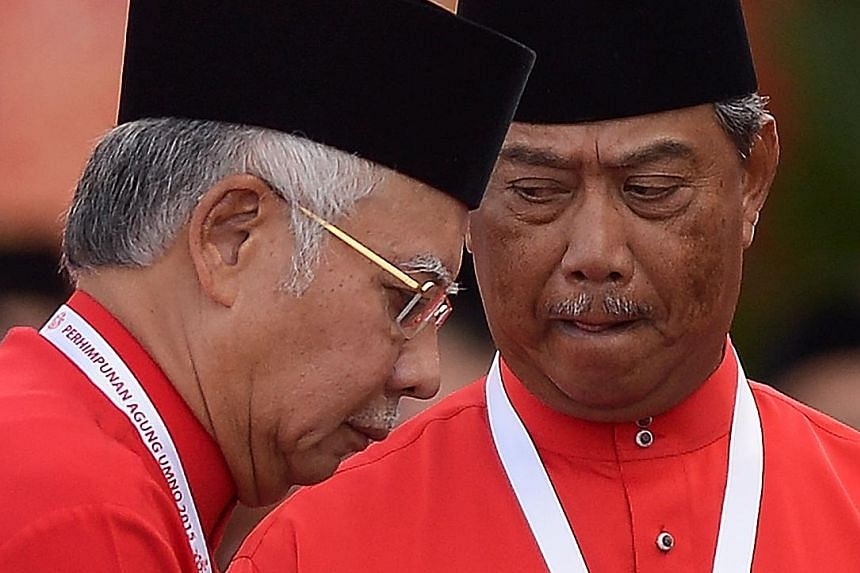 Malaysian Prime Minister Najib Razak (left), who is Umno president, and former deputy prime minister Muhyiddin Yassin at the party's annual congress last December. The suspension of Tan Sri Muhyiddin as Umno deputy president means that he can no long