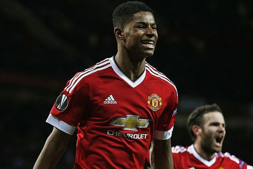 Marcus Rashford (left), who replaced Anthony Martial against Midtjylland, is now Manchester United's youngest scorer in Europe.