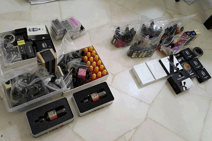 Vaporisers and accessories seized from a suspect's HDB flat on Tuesday. Two suspects were caught peddling their wares online.
