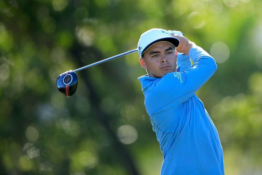 Rickie Fowler plays his tee shot at the par 4, 14th hole.