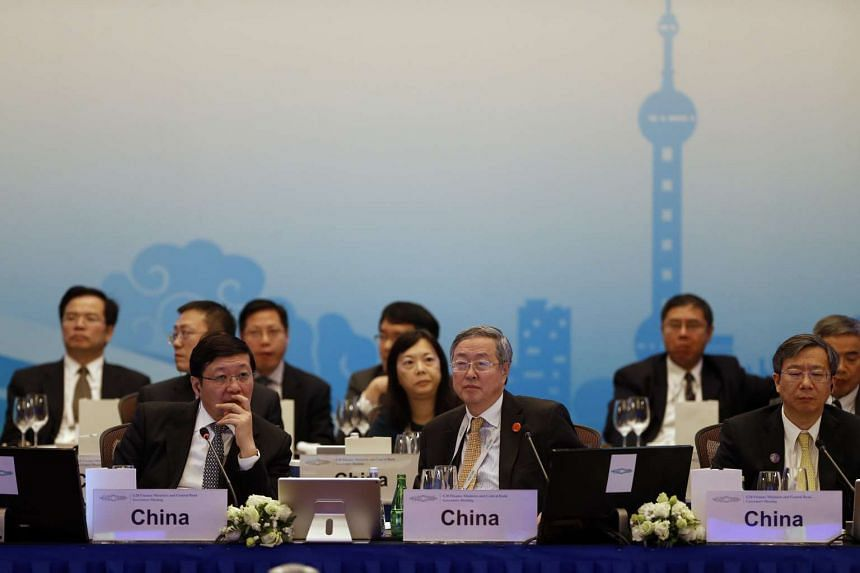 Minister Lou Jiwei (left) and China's central bank governor Zhou Xiaochuan (centre) and People's Bank of China Deputy Governor Yi Gang (right) attending the opening ceremony of the G20 finance ministers and central bank governors meeting in Shanghai,