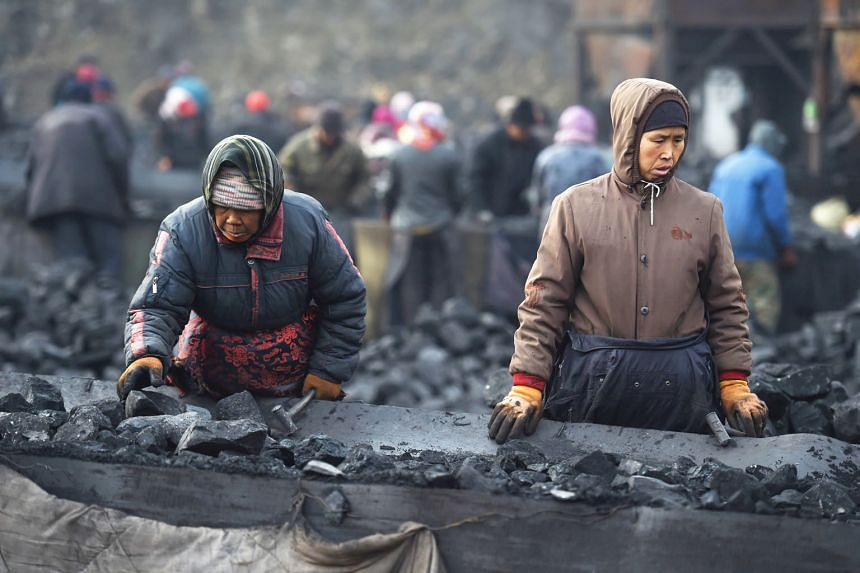 Coal workers in Datong, Shanxi province. Such workers are at risk of losing their jobs if capacity is cut in the next few years.